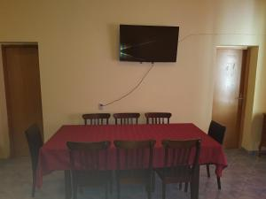 A television and/or entertainment center at Dejan Apartments with Pools
