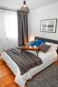 A bed or beds in a room at K Residence Zadar apartment
