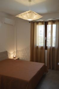 Letto o letti in una camera di Borgo Vigata Residence