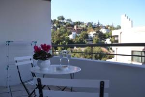 Un balcón o terraza de El Golf Apartments Chile