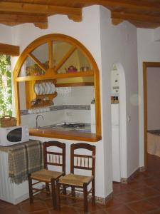 Una cocina o zona de cocina en Apartamentos Buganvilla