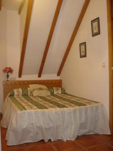 Cama o camas de una habitación en Apartamentos Buganvilla