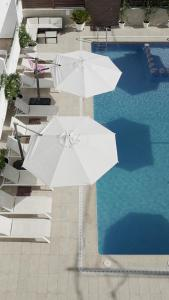 The swimming pool at or near Aparthotel Fleming 50 - Adults Only