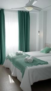 A bed or beds in a room at Aparthotel Fleming 50 - Adults Only