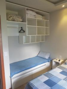 A bed or beds in a room at Apartamento Bracuhy - Peninsula III