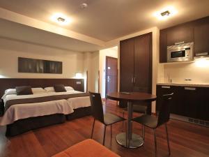 Cama o camas de una habitación en Apartamentos Rurales L'Arquera