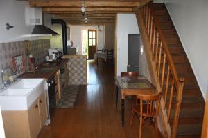 A kitchen or kitchenette at Gîte La Chandelette