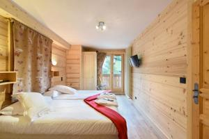 Un ou plusieurs lits dans un hébergement de l'établissement Loc'Hotel Alpen Sports
