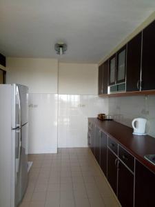 A kitchen or kitchenette at Lumut Valley Resort Condominium