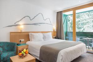 מיטה או מיטות בחדר ב-Alpine Club By Diamond Resorts