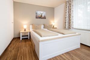 Ein Bett oder Betten in einem Zimmer der Unterkunft Ferienhof Heins