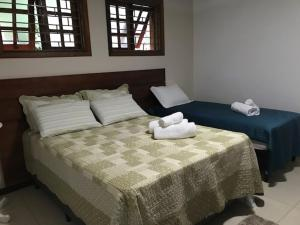 A bed or beds in a room at Residencial Confort