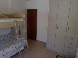 A bunk bed or bunk beds in a room at Galina Holiday Home