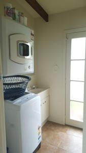 A kitchen or kitchenette at Hot Water Beach Cottage