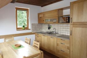 Küche/Küchenzeile in der Unterkunft Pod Ponco Apartments