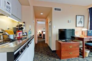A television and/or entertainment center at Rosedale on Robson Suite Hotel