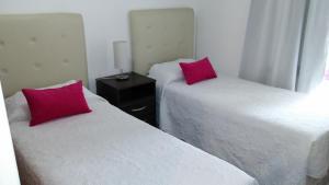 Una cama o camas en una habitación de Departamentos El Ceibo II