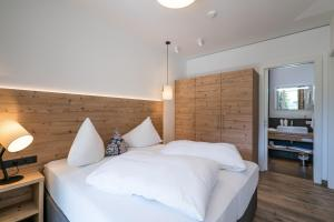 מיטה או מיטות בחדר ב-Adler Resort