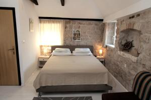 A bed or beds in a room at Apartment Tragurium