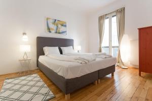 Ein Bett oder Betten in einem Zimmer der Unterkunft Apartment Historic City with Balcony