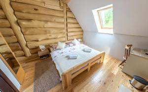 A bed or beds in a room at BeaR's LOG