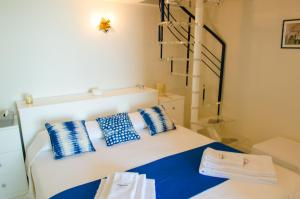 A bed or beds in a room at Villa Elizabeth