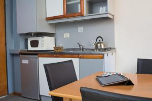 A kitchen or kitchenette at Rosario Suites