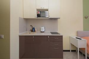 A kitchen or kitchenette at Home Like - ONE plus ONE