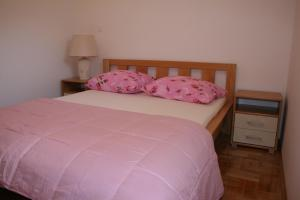A bed or beds in a room at Apartments Mrduljaš