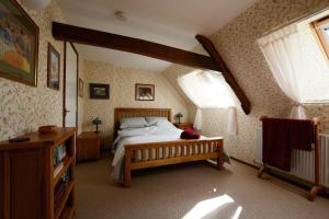 A bed or beds in a room at Barn Loft