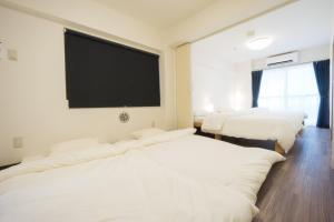 A bed or beds in a room at GOEN inn Tokyo