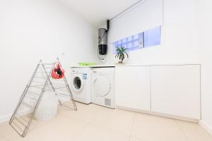A cozinha ou cozinha compacta de Apartamento centro Leiria