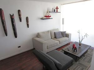 Zona de estar de El Cosmopolita Apartment