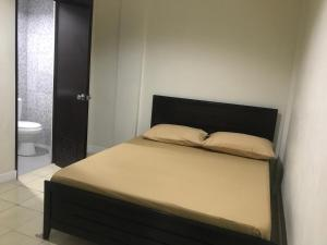 A bed or beds in a room at One Terence Residences