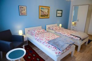 A bed or beds in a room at Beograd Apartement