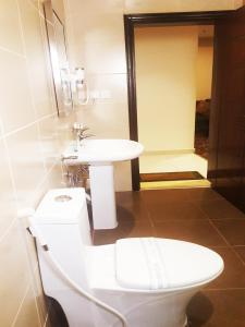 A bathroom at Procare Apart hotel