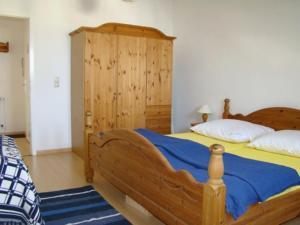 Ein Bett oder Betten in einem Zimmer der Unterkunft Villa Phoenix Wohnung 10