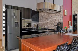 A kitchen or kitchenette at The Terrace Apartments Zambia