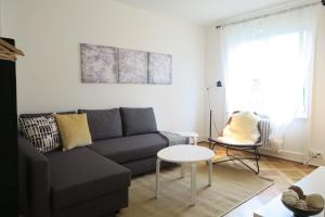 A seating area at Zurich Furnished Apartments
