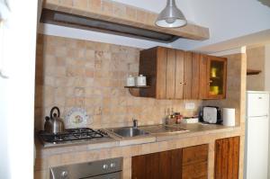 A kitchen or kitchenette at Trulli Casa Alberobello