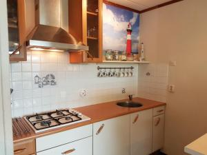 A kitchen or kitchenette at OESTER Bed by the Sea