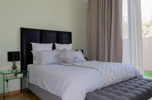 A bed or beds in a room at The Terrace Apartments Zambia