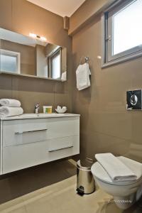 Ένα μπάνιο στο Nereus Luxurious Suites
