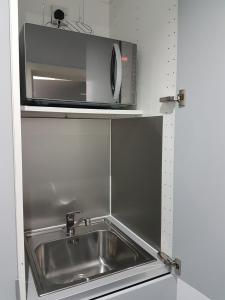 A kitchen or kitchenette at Apartments on the Green