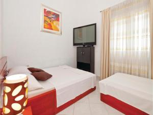 A bed or beds in a room at Apartment Stanici with Sea View IV