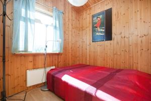 A bed or beds in a room at Tunga Holiday Home