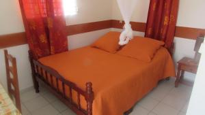 Un ou plusieurs lits dans un hébergement de l'établissement Maison des Alizes