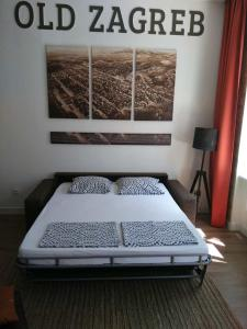 A bed or beds in a room at Apartment Old Zagreb