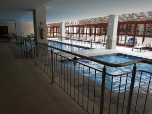 The swimming pool at or close to Flat Vista Azul em Pedra Azul - ES