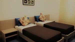 A bed or beds in a room at Casa Nova